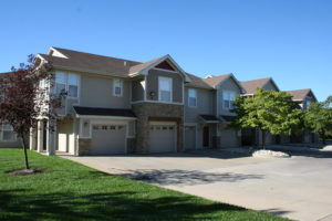 Exterior of Lawrence townhome apartment community with garages