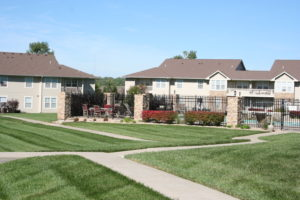 Landscaped grounds of Ironwood Court Apartments with swimming pool