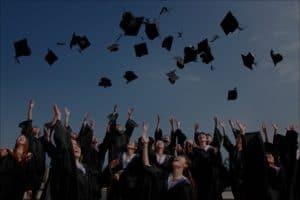 College graduates throwing caps in the air